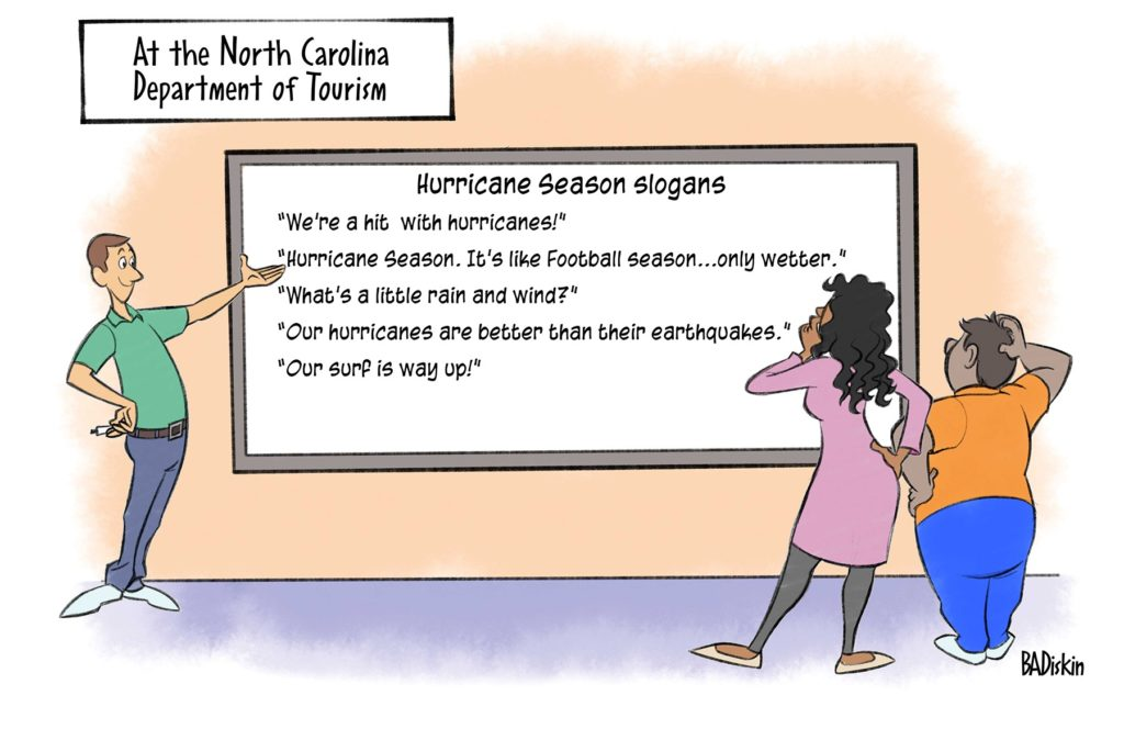 A woman standing in front of a board reading hurricane slogans
